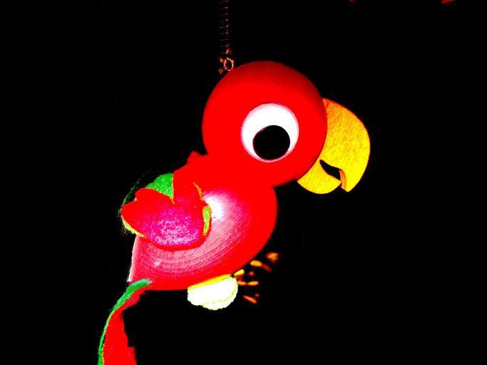 svítící papoušek hračka